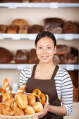 Teenage Waitress Holding Bread Basket — Stock Photo