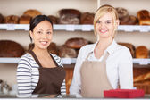 Waitresses Standing Together At Cafe Counter — Stock Photo