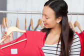 Girl Looking At New Top In Shop — Stock Photo