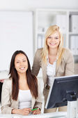 Portrait of two trainees in the office — Stock Photo