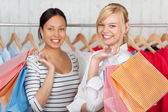 Female Friends Holding Shopping Bags In Shop — Stockfoto