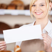 Confident Waitress Holding Blank Sign In Cafe — Stock Photo