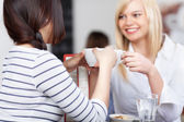 Businesswoman With Coworker Holding Coffee Cup In Cafe — Stock Photo