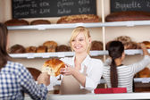 Waitress Giving Breadloaf To Customer — Stock Photo