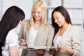 Three trainees in the office — Stock Photo