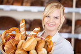 Young Waitress With Bread Basket In Cafe — Stock Photo