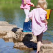 Two little girls playing in the water — Stock Photo