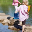 Stock Photo: Two little girls playing in the water