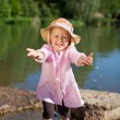 Adorable young girl holding out her arms — Stock Photo