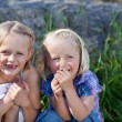 Stock Photo: Two mischievous little sisters