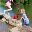 Two little girls outdoors at the lake — Stock Photo