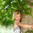 Girl is hugging a tree — Stock Photo