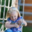 Little girl has fun at playground — Stock Photo