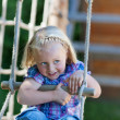 Little girl has fun at playground — Stok fotoğraf