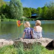 Two little girls fishing at the lake — Stock Photo