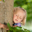 Stock Photo: Little girl loves her tree