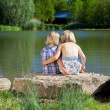 Two loving little sisters at the lake — Stock Photo