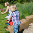 Two little girls playing outdoors — Stock Photo