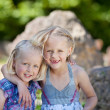 Two little sisters arm in arm — Stock Photo