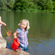 Little girls having fun at the lake — Stock Photo
