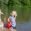 Little girls having fun at the lake — Stock Photo