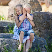 Shy little girl covering her face — Stock Photo