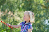 Small blond girl with a magic wand — Stok fotoğraf