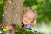 Little girl loves her tree — Stock Photo