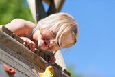 Girl climbing a tower — Stock Photo