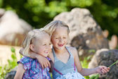 Two little girls in the park — Stock Photo