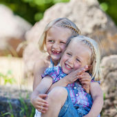 Laughing little blond sisters — Stock Photo