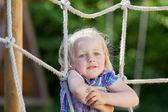 Climbing a net at playground — Stock Photo