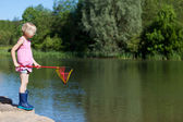 Little girl watching for fish — Stock Photo