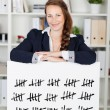 Stock Photo: Smiling womwith tally card