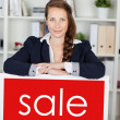 Stock Photo: Saleslady announcing sale