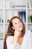 Female day dreaming and smiling — Stock Photo