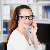 Female call center executive talking to a customer — Stock Photo