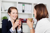 Women executives during a coffee break — Stock Photo