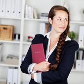 Beautiful pensive businesswoman — Stock Photo