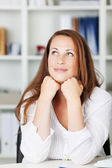 Attractive young female imagining something good — Stock Photo