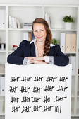 Smiling woman with a tally card — Stock Photo