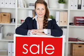 Saleslady announcing a sale — Stock Photo