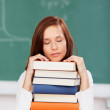 Exhausted student sleeping on her books — Stock Photo