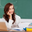 Attractive female student thinking as she studies — Stock Photo #26658011
