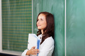 Optimistic female student smiling and thinking — Stock Photo