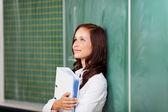 Optimistic female student smiling and thinking — Stock Photo