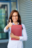 Enthusiastic woman giving a thumbs up — Stock Photo