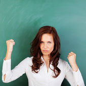 Angry woman shaking her fists — Stock Photo