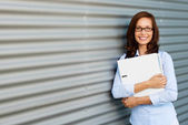 Woman holding laptop — Stock Photo