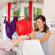 Saleswoman Giving Shopping Bags To Customer — Stock Photo